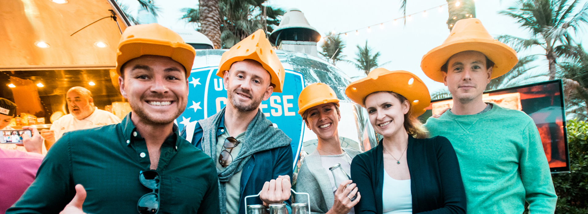 Participants with cheese hats